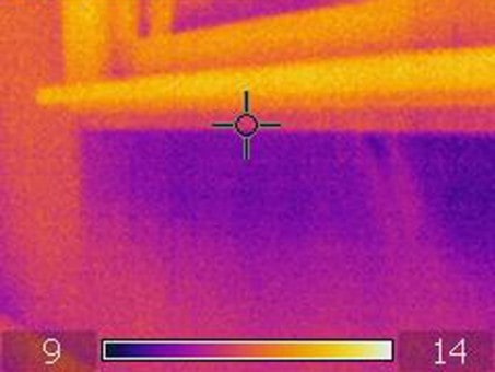 Thermal image of air leaks at the perimeter of an exterior window