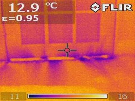Thermal image of the air leaks around the external door perimeter